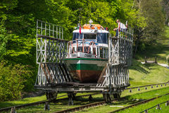 Transportation of a small ship on land Stock Photos