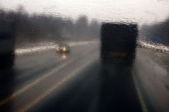 Transportation theme. Road cars theme, motorway. Blurred. Transportation theme. Road cars theme, motorway. Delivery of goods in bad weather snow storm stock image
