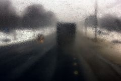 Transportation theme. Road cars theme, motorway. Blurred. Transportation theme. Road cars theme, motorway. Delivery of goods in bad weather snow storm royalty free stock images
