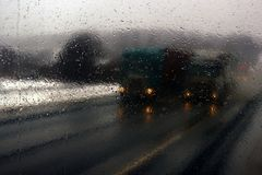 Transportation theme. Road cars theme, motorway. Blurred. Transportation theme. Road cars theme, motorway. Delivery of goods in bad weather snow storm stock photo