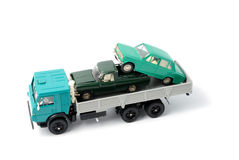 Transportation of toy cars for disposal Stock Images