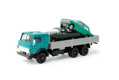 Transportation of toy cars for disposal Royalty Free Stock Photos