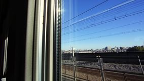 City view from window of moving train or railway. Transportation and travel concept - view to city from window of moving train or railway in japan stock footage
