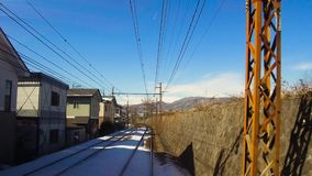 View to suburb from train or railway in japan. Transportation and travel concept - view to suburb of nagano from moving train or railway in japan stock video