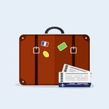 Transportation and travel. Suitcase with stickers, airplane tickets. Vacation tourism. Stock Image