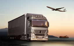 Transportation. By truck, ship and plane Stock Images