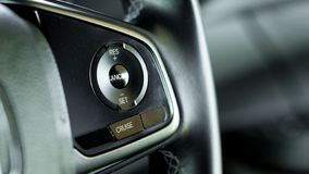 Close up car cruise control on car steering wheel with blurred c stock photos