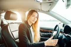 Transportation and vehicle concept - close up of businesswoman driving car stock images
