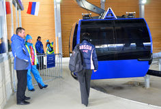 Transportation volunteers and technical staff to help fans when boarding the gondola cableway Royalty Free Stock Images