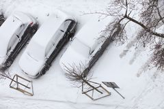 Parked cars covered in snow after blizzard top view. Transportation, winter season and seasonal specific. Parked cars covered in snow after blizzard top view stock photos