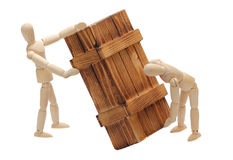 Transportation of wooden box by dolls Stock Photo