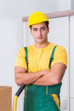 The transportation worker delivering boxes to house Stock Image