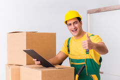 The transportation worker delivering boxes to house Stock Photo