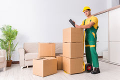 The transportation worker delivering boxes to house. Transportation worker delivering boxes to house Royalty Free Stock Image