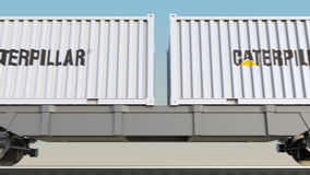 Transporte ferroviario de envases con Caterpillar Inc LOGOTIPO 3D editorial que rinde el clip 4K stock de ilustración