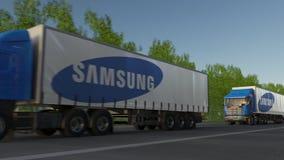 Transporte semi caminhões com o logotipo de Samsung que conduz ao longo da estrada de floresta Rendição 3D editorial Fotos de Stock