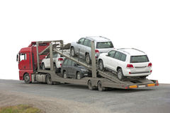 Transporter with cars in the back Stock Photo