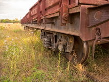 Transporter freight car old. Freight car close-up truck on old rails on wheels loaded with stone royalty free stock image