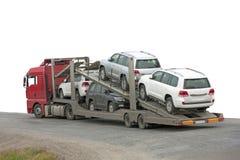 Transporter med bilar i baksidaen arkivfoto