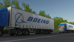 Transportez semi les camions avec le logo de Boeing Company conduisant le long du chemin forestier Rendu 3D éditorial Image libre de droits