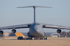 Transporting airplane. Military plane of transportation of materials and people Stock Photos