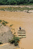 Transporting bamboo trees on the river Stock Photos