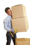 Transporting boxes. Happy man carrying two boxes Stock Image