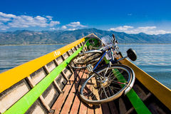 Transporting bycicles in the boat. Inle Lake, Myanmar. stock photos