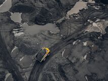 Free Transporting Coal On Yellow Large Dump Truck. Open Pit Mine Industry Top Aerial View Stock Photo - 211236630