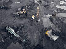 Free Transporting Coal On Yellow Large Dump Truck. Open Pit Mine Industry Top Aerial View Stock Photo - 211236650