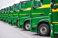 Transporting freighting service lorry trucks in row stock image