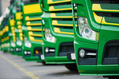 Transporting freighting service lorry trucks in row. Transporting freighting service company. commercial logistics delivery lorry trucks in row Royalty Free Stock Photography