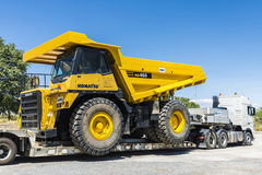 Transporting a large truckload. Granada, Spain - August 18, 2015: Transportation of a large dump truck Komatsu in Granada, Spain on August 18, 2015 Stock Photography