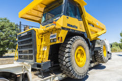 Transporting a large truckload. Granada, Spain - August 18, 2015: Transportation of a large dump truck Komatsu in Granada, Spain on August 18, 2015 Royalty Free Stock Photo
