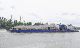 Transporting marine crane parts along the river in Rostov-on-Don Royalty Free Stock Images