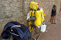 Transporting milk in cans on bike Royalty Free Stock Images