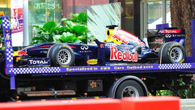 Transporting a Red Bull Racing F1 RB6 car. Red Bull Racing F1 RB6 car being transported after Red Bull Speed Street Singapore 2011 event on 24 April 2011 at Royalty Free Stock Image