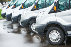 Transporting service company. commercial delivery vans in row. Freight services. commercial delivery vans in row at transporting carrier shipping service company Stock Photography