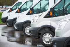 Transporting service company. commercial delivery vans in row Stock Photos