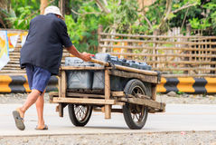 Transporting water in rural areas in asia Stock Photo
