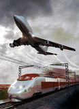 Transports. A big plane flying above a modern high-speed train on its railroad, representing two of the most importants means of  transportation by the world Stock Photo