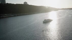 Transprt, reservoirs, travel, navigation concept - aerial survey from height bridge ower pond with silhoette boats ships