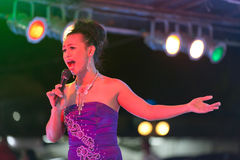 Transsexual singer. Transsexual ladyboy singer performing show on stage, Thailand Royalty Free Stock Photos