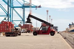 Free Transshipment Terminal For Loading Steel Products To Sea Vessels Using Shore Cranes And Special Equipment In Port Pecem, Brazil, Royalty Free Stock Photos - 125055248