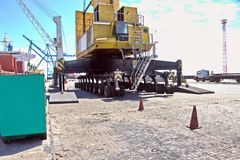 Free Transshipment Terminal For Loading Steel Products To Sea Vessels Using Shore Cranes And Special Equipment In Port Pecem, Brazil, Stock Photography - 125055902