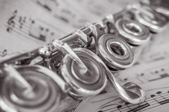 Transversal Flute Detail. Transversal flute instrument detail, over a music sheet Royalty Free Stock Photo