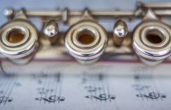 Transversal Flute Detail. Transversal flute music instrument detail, over a music sheet Stock Photography