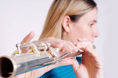Transverse flute. Young woman playing transverse flute Royalty Free Stock Photography