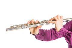 Transverse flute. Clouse up view fingers playing on the transverse flute. Isolated on a white background Stock Photo