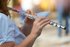 Transverse flute played by a girl.  Stock Images